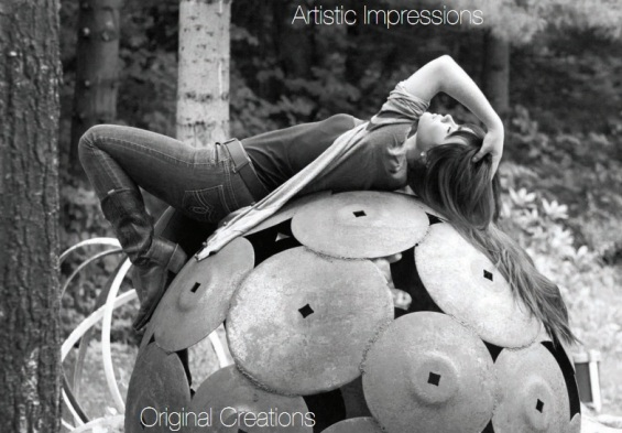architectural orb with girl laying across it